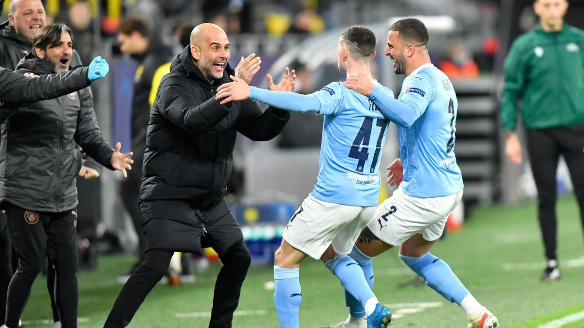 Cái ôm đầy cảm xúc của Pep và Phi Foden trước chiến thắng tại tứ kết Champions League